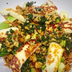 Chickpea and quinao hot salat with halloumi and honey walnut dressing
