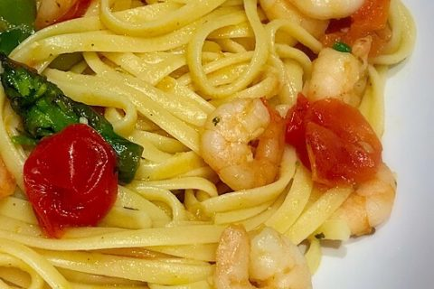 Linguine with asparagus and prawns garnished with fresh pecorino
