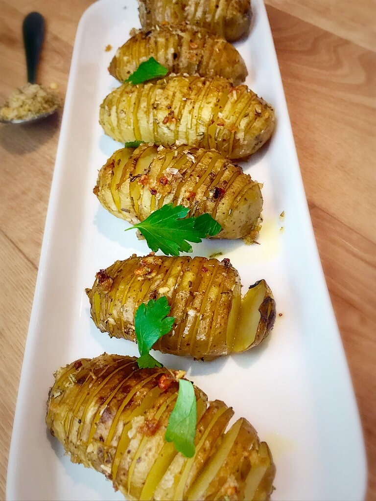 Baby hassleback potatoes roasted and seasoned with butter and ravishing rosemary spice blend by SpiceWay